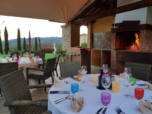 Picture of the loggia with the fireplace for barbecue at the Villa Rey