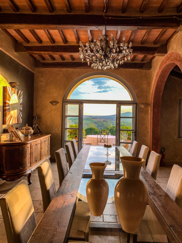 Picture of the high-class furnished dining room with view into the umbrian landscape